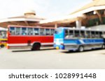 blur of the bus station in the... | Shutterstock . vector #1028991448