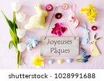 easter flat lay  joyeuses... | Shutterstock . vector #1028991688