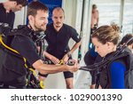 diving instructor helps a... | Shutterstock . vector #1029001390