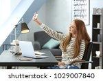 beautiful smiling woman taking...   Shutterstock . vector #1029007840
