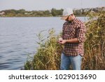 young unshaven man in checkered ... | Shutterstock . vector #1029013690