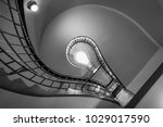 Small photo of Prague, Czech Republic- February 18, 2018: Bulb shaped cubism style stairs in the House of the Black Madonna which is a cubist building in the Old Town area of Prague, Czech Republic