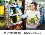 young spanish woman choosing... | Shutterstock . vector #1029024133