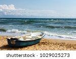 Old row boat on the sandy beach ...