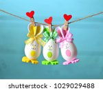 easter eggs hanging on rope on... | Shutterstock . vector #1029029488