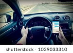 dangerous driving while writing ...   Shutterstock . vector #1029033310