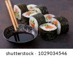 close up sushi roll with soy... | Shutterstock . vector #1029034546