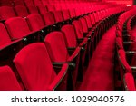 red seats in a empty theater... | Shutterstock . vector #1029040576