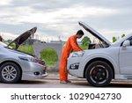 mechanic using a laptop... | Shutterstock . vector #1029042730