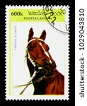 Small photo of MOSCOW, RUSSIA - NOVEMBER 26, 2017: A stamp printed in Lao People's Democratic Republic shows Cold-blooded Horse (Equus ferus caballus), Draft horses serie, circa 1996