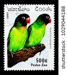 Small photo of MOSCOW, RUSSIA - NOVEMBER 26, 2017: A stamp printed in Lao People's Democratic Republic shows Black-cheeked Lovebird (Agapornis nigregenis), Parrots serie, circa 1997