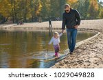 father holding his daughter's... | Shutterstock . vector #1029049828
