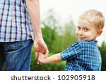 little boy holding the hand of... | Shutterstock . vector #102905918
