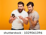 portrait of a two cheerful... | Shutterstock . vector #1029061396