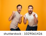 portrait of a two cheerful... | Shutterstock . vector #1029061426