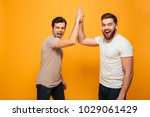 portrait of a two delighted... | Shutterstock . vector #1029061429