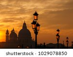 venice sunset with old domes ... | Shutterstock . vector #1029078850