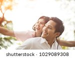 young couple in the park. | Shutterstock . vector #1029089308