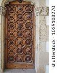 ancient engraved wooden  doors... | Shutterstock . vector #1029103270
