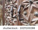 ancient engraved wooden  doors... | Shutterstock . vector #1029103288
