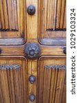 ancient engraved wooden  doors... | Shutterstock . vector #1029103324