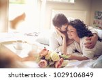 happy young couple in bed... | Shutterstock . vector #1029106849