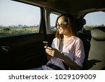 beautiful woman is using a... | Shutterstock . vector #1029109009