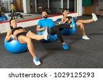 fitness people doing leg raises ... | Shutterstock . vector #1029125293