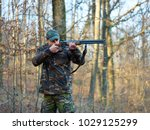 hunter in camo suit with double ... | Shutterstock . vector #1029125299