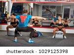 fitness trainer and girls doing ...   Shutterstock . vector #1029125398