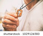 the wooden cross necklace on...   Shutterstock . vector #1029126583