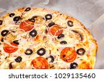 thin pizza on a wooden tray... | Shutterstock . vector #1029135460