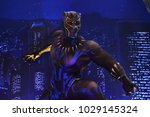 Small photo of Bangkok, Thailand - February 18, 2018: Black Panther Model With A Standee of A Marvel Superhero Movie Black Panther Display at the theater.