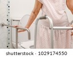 elderly woman holding on... | Shutterstock . vector #1029174550