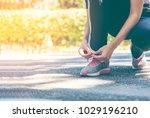 female runner preparing to go... | Shutterstock . vector #1029196210