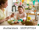 mother and daughter celebrating ... | Shutterstock . vector #1029197314