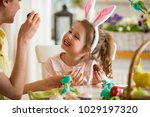mother and daughter celebrating ... | Shutterstock . vector #1029197320