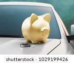 golden piggy bank on new car ... | Shutterstock . vector #1029199426