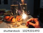 bengal lights in hand against... | Shutterstock . vector #1029201493
