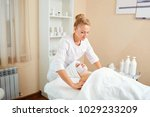 the beautician makes a mask for ... | Shutterstock . vector #1029233209