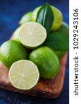 fresh lime on dark background   ... | Shutterstock . vector #1029243106