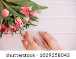 the girl hugs her bouquet with...   Shutterstock . vector #1029258043