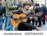 London, United Kingdom, 18th Febuary 2018:- A street perfomer perfoming as part of the festivities to celebrate Chinese New Year in London's Chinatown area, for the year of the dog 2018 - stock photo