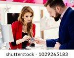 young elegant man buying wrist... | Shutterstock . vector #1029265183