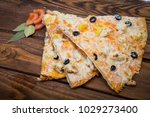 pizza with pineapple on a...   Shutterstock . vector #1029273400