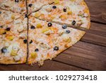 pizza with pineapple on a...   Shutterstock . vector #1029273418
