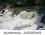 Water Rushing Over A Wier...