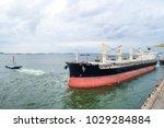 tug boat pulls large bulk... | Shutterstock . vector #1029284884