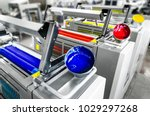 Small photo of Offset printer press in industry plant. Printing machine print daily newspapers. Detail of four color units, cyan, magenta, yellow and black