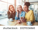 three young women that are... | Shutterstock . vector #1029326860